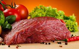 Fresh raw beef. Fresh beef and vegetables on wooden cutting board Stock Photography