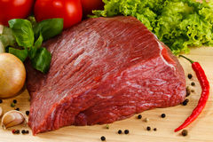 Fresh raw beef. Fresh beef and vegetables on wooden cutting board Stock Photo