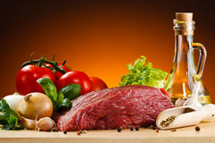 Fresh raw beef. Fresh beef and vegetables on wooden cutting board Royalty Free Stock Photos