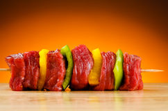Fresh raw beef. Fresh beef and vegetables on wooden cutting board Royalty Free Stock Image