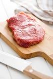 Fresh raw beef. On white kitchen table Royalty Free Stock Photo