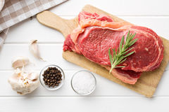 Fresh raw beef. On white kitchen table Royalty Free Stock Photography