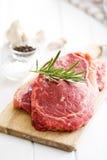 Fresh raw beef. On white kitchen table Stock Image