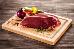 Fresh raw beef. On wooden background Stock Photo