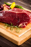 Fresh raw beef. On wooden background Royalty Free Stock Photography