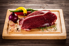 Fresh raw beef. On wooden background Stock Photos