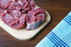 Fresh raw beef. On wooden cutting plate Royalty Free Stock Photography