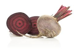 Fresh raw Beetroot isolated isolated on white. Sliced red beet one cut in two halves and whole bulb isolated on white background cross section zoned flesh Stock Photography