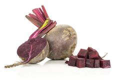 Fresh raw Beetroot isolated isolated on white. One red beet with section half and sliced squared pieces young bulbs isolated on white background Stock Images