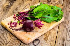 Fresh raw beetroot, sliced on kitchen cutting board. Studio Photo Stock Photos