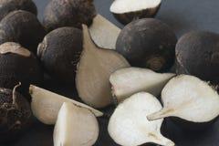 Fresh raw black turnip. On table Stock Images