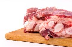 Fresh raw briskets. Fresh raw meat on wooden board Royalty Free Stock Image