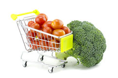 Fresh raw  broccoli, cherry tomatoes on trolley. Isolated on white background Stock Photography