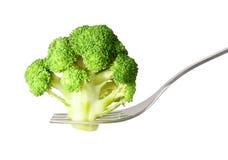 Fresh raw broccoli on fork isolated Stock Photos