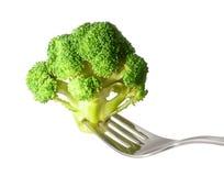 Fresh raw broccoli on fork isolated. Fresh raw broccoli with fork isolated on white background Stock Images