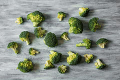 Fresh Raw Broccoli. On grey wooden background Royalty Free Stock Image