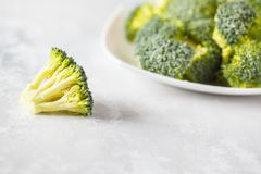 Fresh raw broccoli on a light background. Healthy vegan food concept Royalty Free Stock Photography
