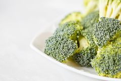 Fresh raw broccoli on a light background. Healthy vegan food concept Stock Image