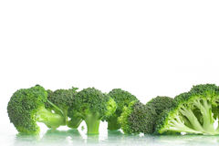 Fresh Raw Broccoli. Over a wet glass surface Royalty Free Stock Image