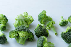 Fresh raw  broccoli on white board. Food closeup Stock Photos