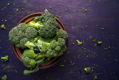 Fresh raw broccoli. On a wooden table, top view, copy space Royalty Free Stock Photo