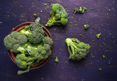 Fresh raw broccoli. On a wooden table, top view, copy space Stock Images