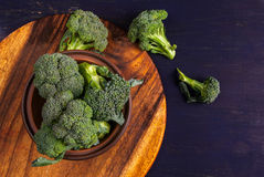 Fresh raw broccoli. On a wooden table, top view, copy space Stock Photography