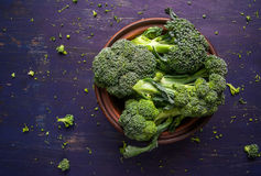 Fresh raw broccoli. On a wooden table, top view, copy space Stock Photos