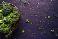 Fresh raw broccoli on a wooden table. Top view, copy space Stock Photo