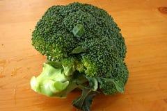 Fresh raw brocolli. Fresh raw whole brocolli on wooden background Stock Photography