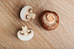 Fresh raw brown chestnut mushrooms on wooden background Stock Image