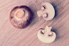 Fresh raw brown chestnut mushrooms on wooden background Royalty Free Stock Images