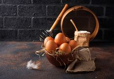 Fresh raw brown eggs in bowl. Selective focus Stock Images