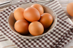 Fresh raw   brown eggs in  bowl Stock Photo
