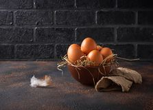 Fresh raw brown eggs in bowl. Selective focus Stock Photo