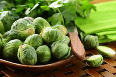 Fresh raw brussels sprouts. On a wooden table Stock Image