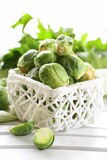 Fresh raw brussels sprouts. On a wooden table Royalty Free Stock Photography