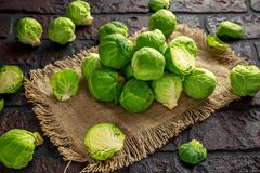 Fresh raw brussels sprouts on a old stone rustic table.  Royalty Free Stock Image
