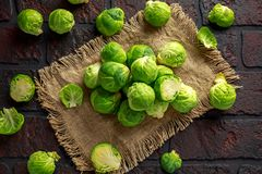 Fresh raw brussels sprouts on a old stone rustic table.  Stock Image