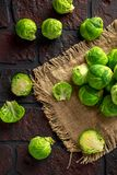 Fresh raw brussels sprouts on a old stone rustic table.  Stock Photos