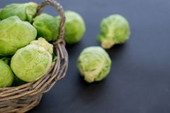 Fresh raw brussels sprouts on a wooden table. Top view with copy space. Dark background. table. Fresh raw brussels sprouts on a wooden table Royalty Free Stock Photos