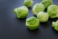 Fresh raw brussels sprouts on a wooden table. Top view with copy space. Dark background. table. Fresh raw brussels sprouts on a wooden table Stock Photo