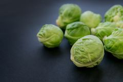 Fresh raw brussels sprouts on a wooden table. Top view with copy space. Dark background. table. Fresh raw brussels sprouts on a wooden table Stock Photos