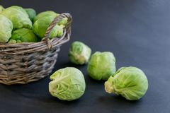 Fresh raw brussels sprouts on a wooden table. Top view with copy space. Dark background. table. Fresh raw brussels sprouts on a wooden table Stock Image