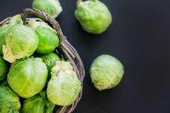 Fresh raw brussels sprouts on a wooden table. Top view with copy space. Dark background. table. Fresh raw brussels sprouts on a wooden table Royalty Free Stock Images