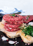 Fresh raw burger cutlets. From the farmers market on a rustic cutting board. Selective focus Stock Image