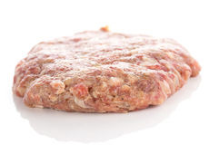 Fresh raw burger cutlets. Isolated on white background Stock Photos