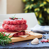 Fresh raw burger cutlets, outdoor background Stock Photo