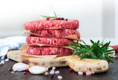 Fresh raw burger cutlets, outdoor background Stock Images