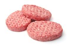 Fresh raw burger patties. Isolated on white Royalty Free Stock Photos